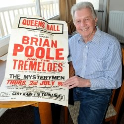 Local musician Brian Tilke of The Mysterymen with show poster Credit North Devon Journal